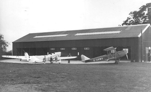 The completed second hangar with resident and visiting aircraft in front.