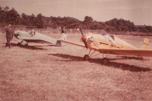 Two of the Tiger Club's Druine D.31 Turbulents at Denham in 1958 during a fly-in, G-APBZ furthest from the camera. David Ogilvy and Scott Hill are seen admiring the aircraft.